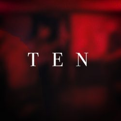 Ten on a red blurred background