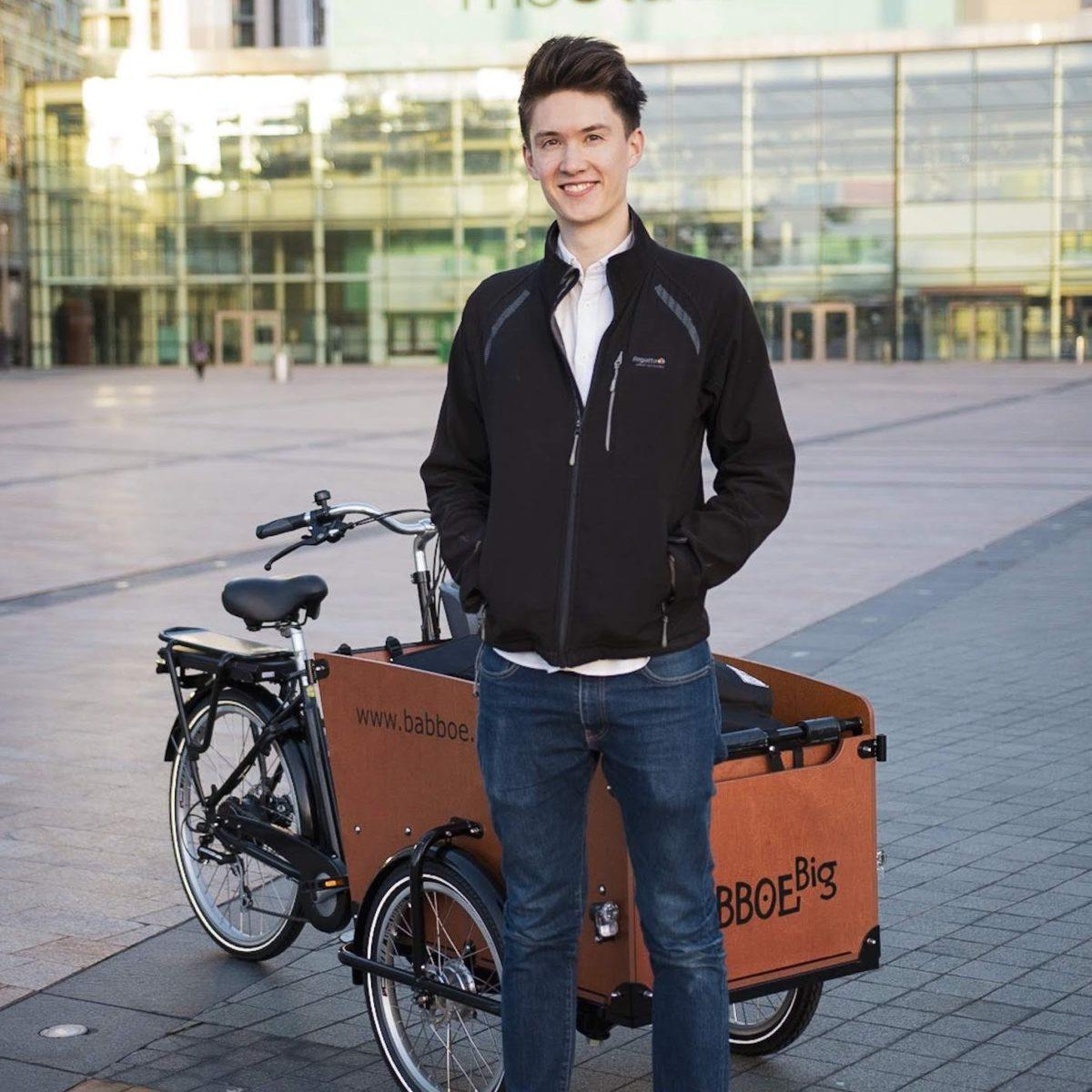 Ben Horrigan with Studio 91's cargo bike, which is full of video production equipment.