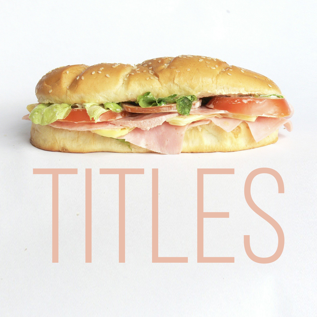 "A sub sandwich with the word ""titles"" underneath"